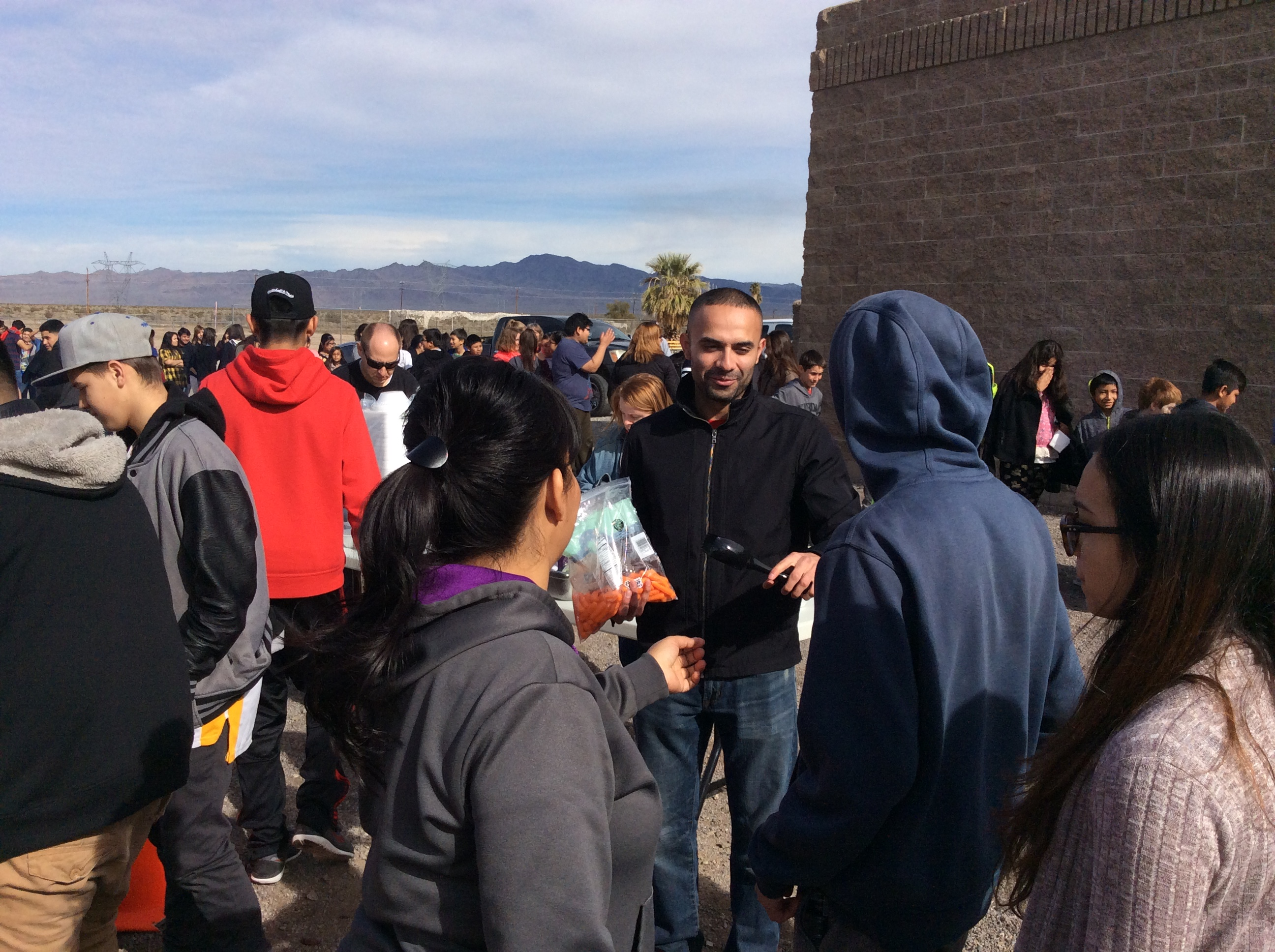 Students in line for stone soup.